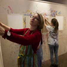 Tish Sjoberg (left) prepared the painting room for an evening of Art Aerobics at her Expressive Arts studio in North Park. — Earnie Grafton